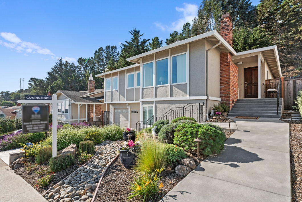 Got space? We do. Check out this expansive updated home in prestigious Portola Highlands. This home has undergone both a handsome remodel and large expansion. The enticing kitchen features a centerpiece island with pendant lighting, eat at bar and separate dining enclave. Stunning mosaic inlayed tile backsplash compliments the granite counters with a stainless basin style sink—all atop rich cherry wood cabinets and soft close drawers. Stainless appliances comprise top brands such as Jenn-Aire, Samsung, KitchenAid, and Sharp including a gas stove with side grilling station, dual built-in ovens, French door style refrigerator, silent style dishwasher and built-in microwave. The original kitchen now serves as an expansive pantry and prep area with copious cabinetry and storage areas for the most discerning chef. Adjacent the kitchen is a large dedicated formal dining area with classic wainscotting balanced by a neutral taupe color scheme. The living room features brilliant cherry hardwood flooring, recessed lighting, crown moldings and stunning views of the San Francisco Bay and SFO airport. The gas starter wood-burning fireplace is flanked by marble inlay and a timeless wooden mantle. Down the hallway is a remodeled communal bath with jetted tub, glass shower door, Toto commode, and rich cabinetry below the granite vanity. Three spacious bedrooms are on this level including an expanded owner's ensuite with access to the rear private patio. Exclusive to the home, is a very large family room addition downstairs, along with two more bedrooms, a spacious office, and another full updated bath. This stylish home offers serenity, functionality, and value. Its large living area is ideal for gatherings of an immediate family, or managing all members of an entire household. This location is popular because of its close proximity to major travel arteries—Highway 101, 280 and 380 are a few miles away, and access to hiking trails at Crystal Springs reservoir is nearby and the Paci